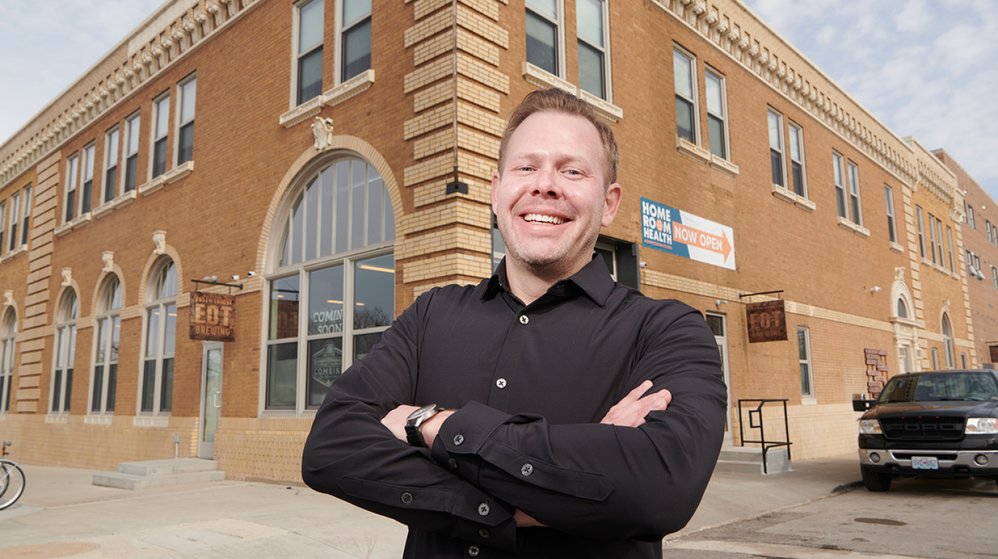 Caleb Buland, Principal at Exact Partners, in front of the Wonder Shops + Flats in Kansas City, MO.