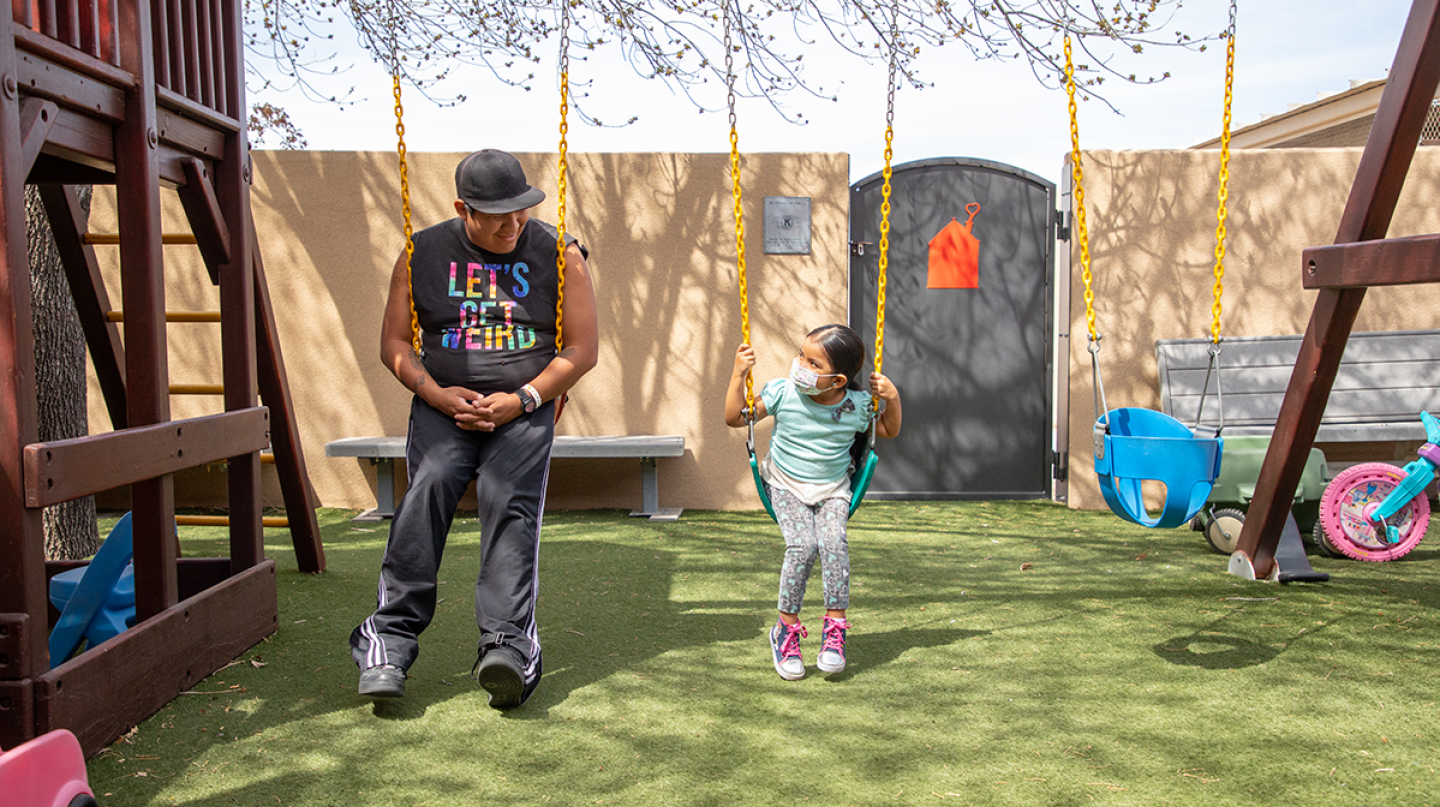 Turquoise and her dad, Michael, enjoy time on the swingset at the Ronald McDonald House® in Albuquerque, NM.